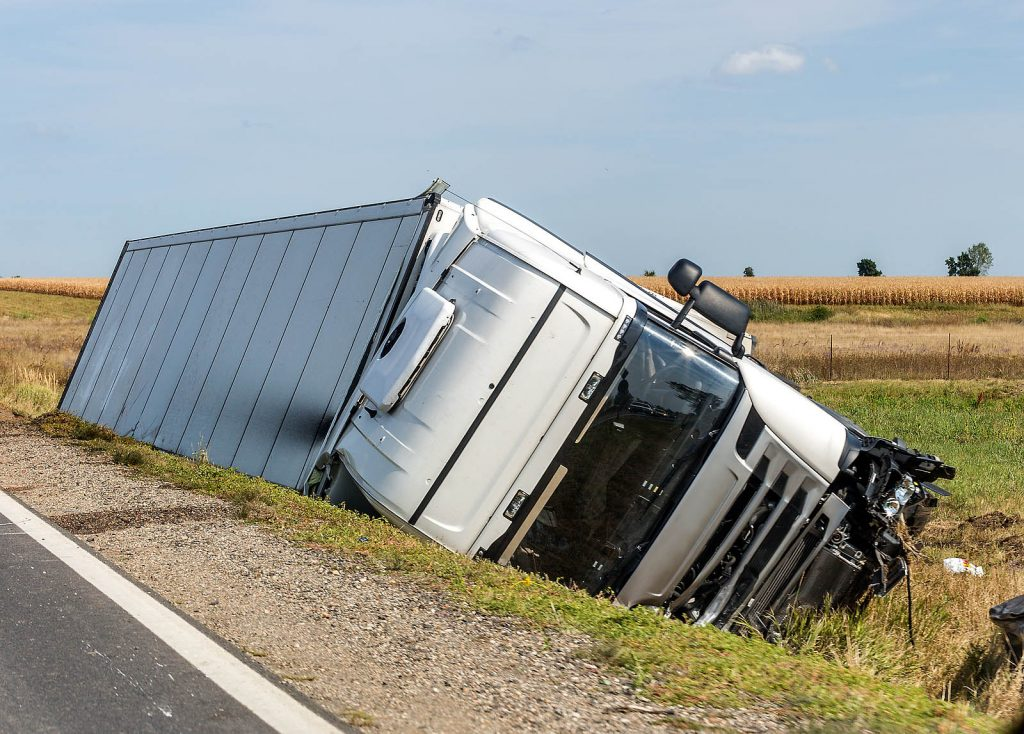 semi truck accident - tipped over